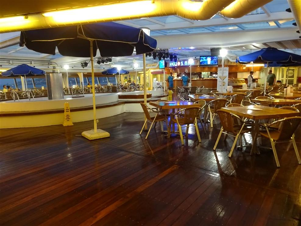 Pool area midships with Helios Bar.  Deck 9 Leda Buffet restaurant adjacent