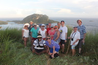 Our hiking group near Ratu Namasi school with a peek of the boat in the bac
