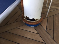 Photo showing large, rusty hole in one of the support pillars on deck 15.