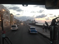 Ride along Malecon at night on way to Hotel Nacional de Cuba for Parisien C