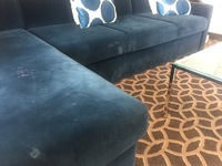 Stained sofas in suite