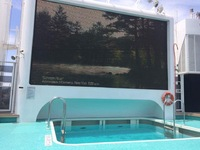 Cinema screen at adult pool