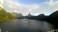 Our anchorage at Moorea.  Crystal clear water, soaring mountains and 100 shades of lush green hill sides.