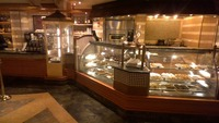 We loved the International café.  Great coffees, cappuccino and fresh pastries plus hot snacks 24 hours a day.
