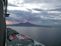 Sun coming up behind mount Vesuvius