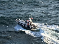 Pilot boat bobbing about off St Peter Port