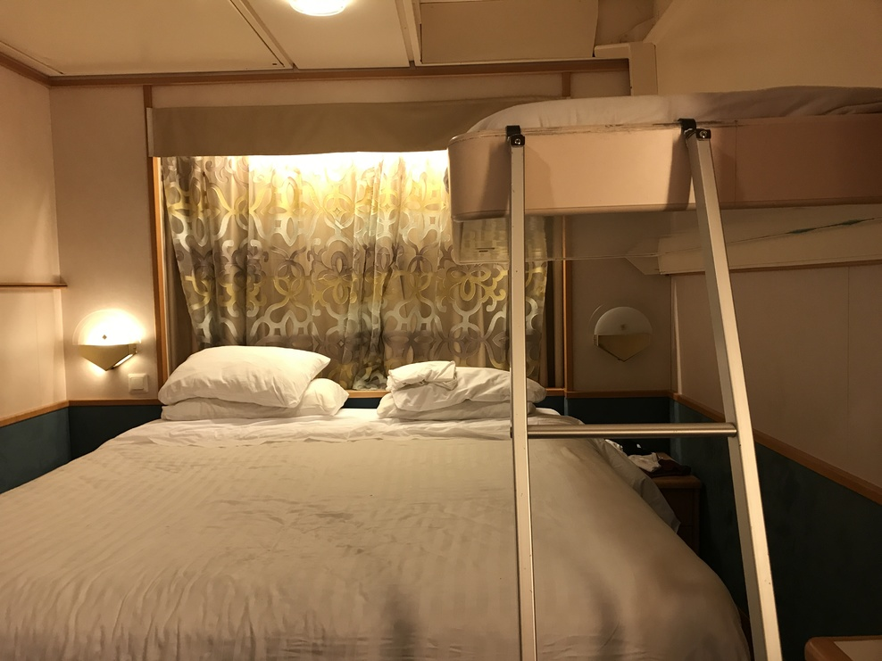 This is a photo of the cabin with the bunk bed open.  Ridiculous!