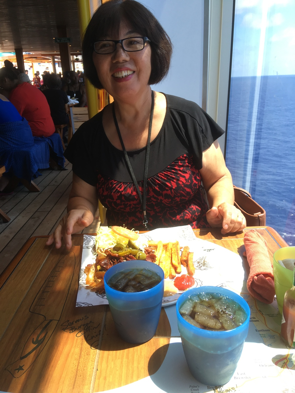 Enjoying a Guy's Burger Joint hamburger aboard Carnival Valor.