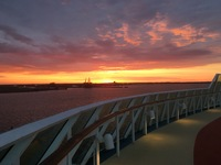 Sunrise off the starboard side of ship as we return to Baltimore