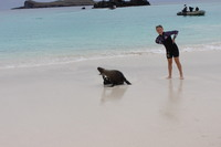 Young girl on our cruise is mimicking the sea lion that came to play