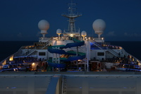 This is a night time photo of the slide located on the Lido deck