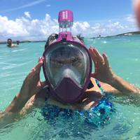 Teach Mom how to snorkel. Coco Cay is clear and shallow and ideal for begin