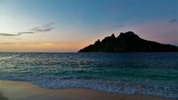 Monu Island Fiji at sunset, taken from Monuriki Island (the island where th