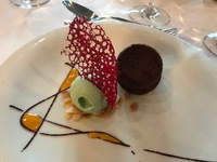 Chocolate cake and pistachio icecream desert.