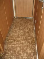 poorly installed carpet, potentialtripping hazard at door