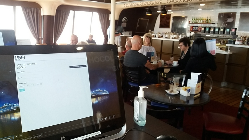 A cafe near the front of the Jewel on deck 12, where other computers are av