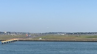 View of planes take off and landing (Boston Logan Airport)  from the QM2