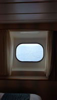 Porthole window from inside room. #9032 did not have an obstructed view