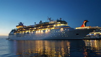 The ship exterior (Majesty of the Seas) from the port in Nassau at night
