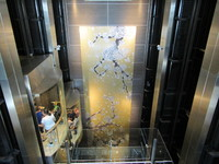 Main elevator shaft is beautifully decorated.