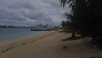 A relaxing day at Junkanoo beach in Nassau. Beach is located after the bar shacks and volleyball. Security present.