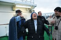 Crossing the Arctic Circle ceremony - I got ice and icy water down my bck!