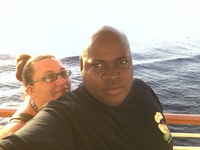 Me and my fiancé on a small ship heading back to the cruise ship