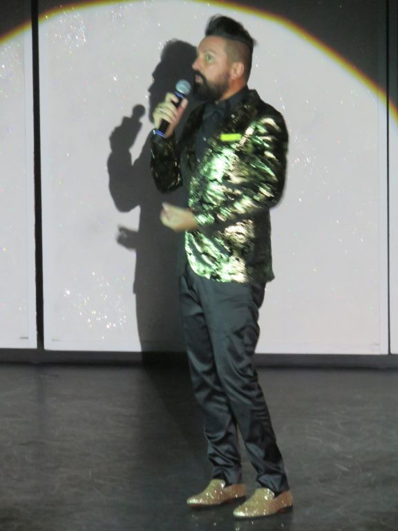 Cruise director in jazzy clothes and sparle shoes