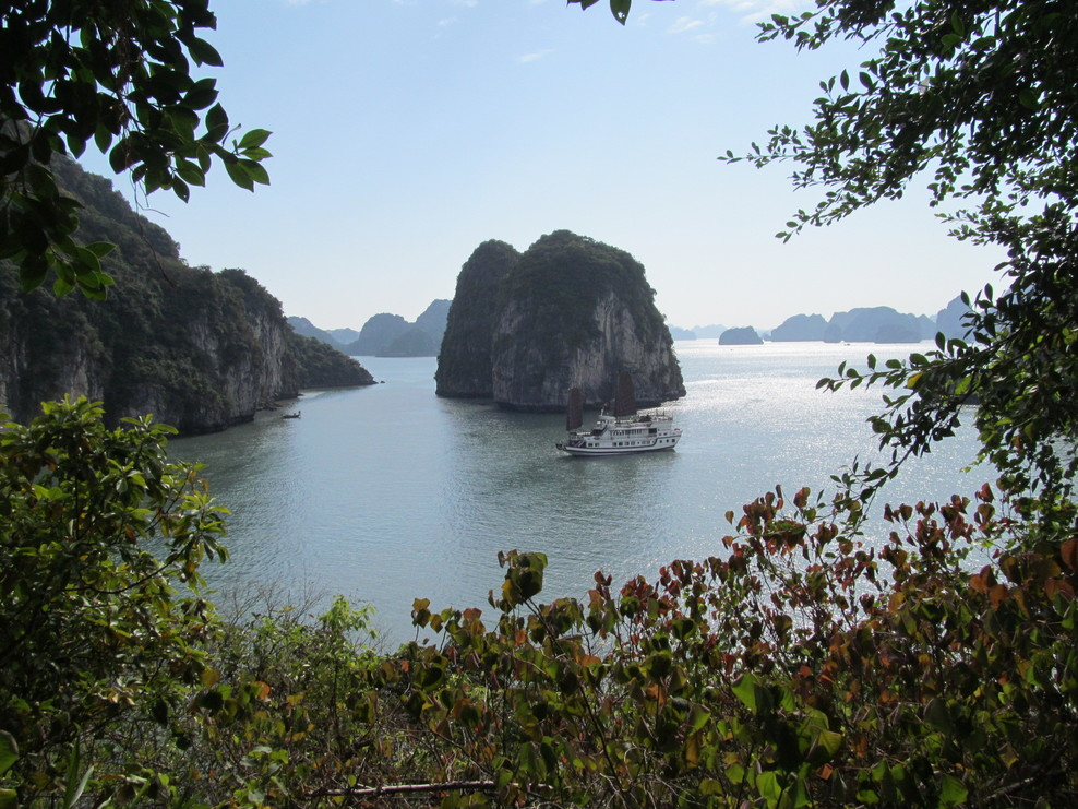 Asian Junk Boat touring in Halong Bay, Vietnam.  This picture was taken from the Caves showing the rock formations that make up 3,000 peaks.