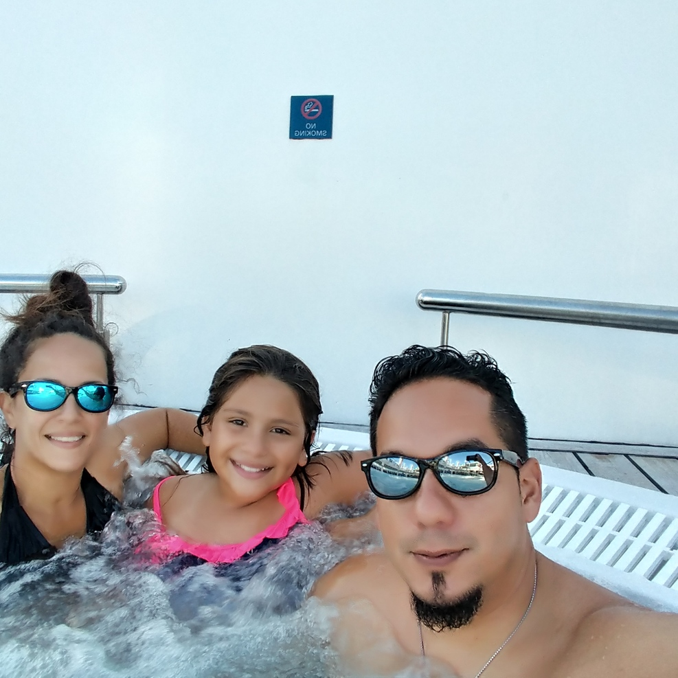 My hubby,little & I relaxing in 1 of the Jacuzzis on the cruise