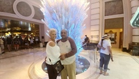 My husband and I were standing in front of a sculpture in Atlantis, Bahamas
