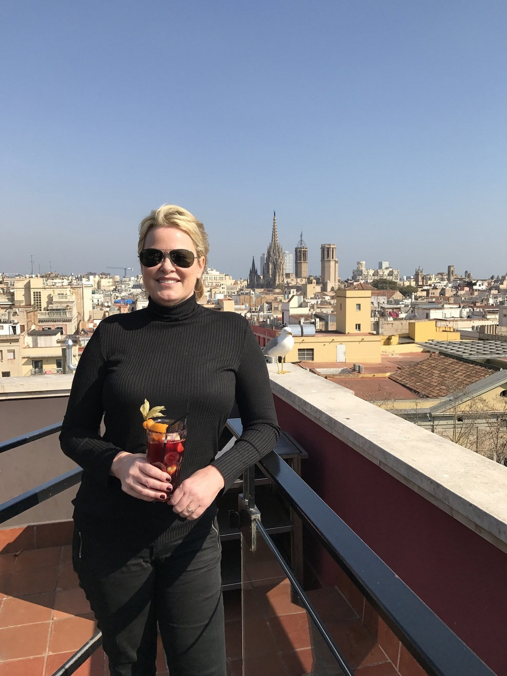 Enjoying a sangria on a Barcelona rooftop lounge!