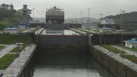 Cargo ship ahead of Carnival Splendor in the Panama Canal locks.