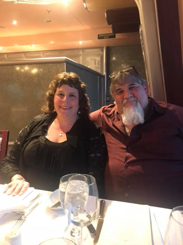 Laura and Shawn Charles at elegant dinner at 6 pm