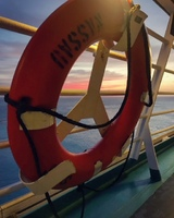 Sunset onboard the Adventure of the Seas, through the life saver.