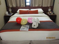 Our cabin, with card, balloons and dog made out of towels, kindly left by s