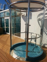 An outdoor shower located near the cantelever hot tubs.