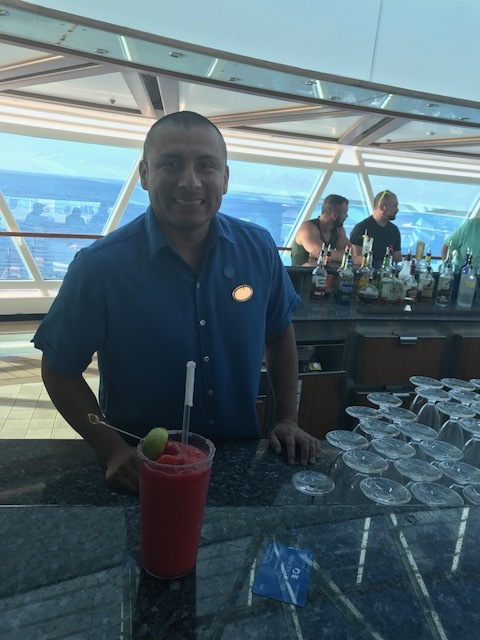 One of the bartenders making delicious Strawberry Daiquiris.