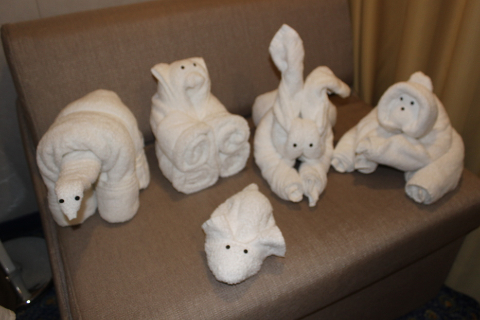 Our collection of towel animals at the end of the cruise.