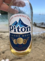 Enjoying local beer at Marigot Bay