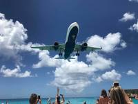 Moho Beach.... watch airplanes land as you sit on the beach.