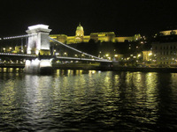 The Chain Bridge in Budapest with other beautiful lights in the background.