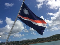 The ships registry flag....Marshall Islands