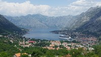 This is our view from a restaurant in Montenegro with our cruise ship in po