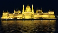 The Parliament building at night in Budapest.