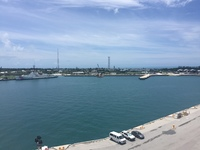 You dock at the Navy base in Key West which requires that you take a tram/t