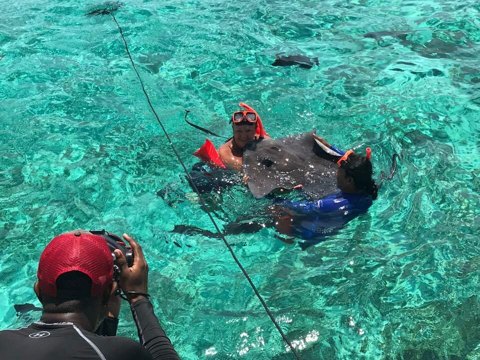 Grand Cayman Islands - Barrier Reef snorkeling.  I am holding and kissing a