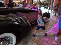 Grandson loved the neat car on display on ship.