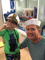 Enjoyed on-board gift shops. Son and grandson sporting caps.