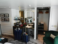 Desk area and closet in stateroom